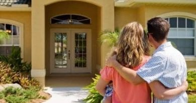 couple out the front of a house with baby| homebuyers