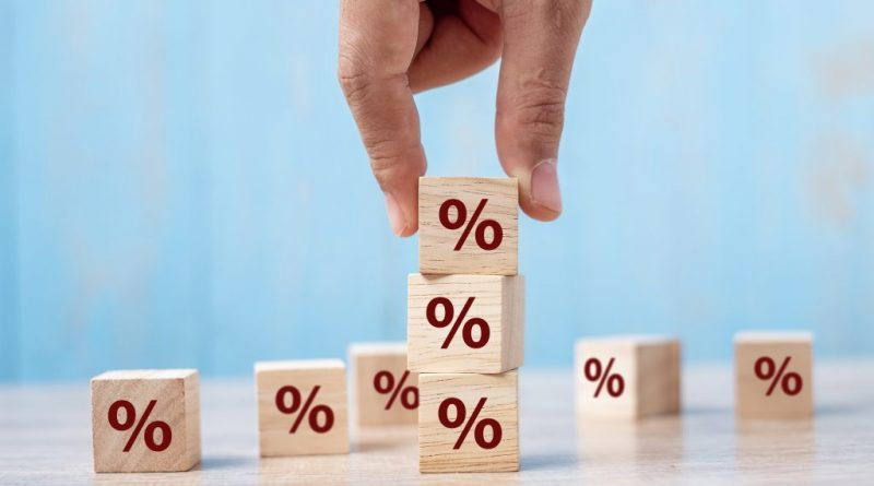 stacking blocks with on them| How interest rates affect real estate