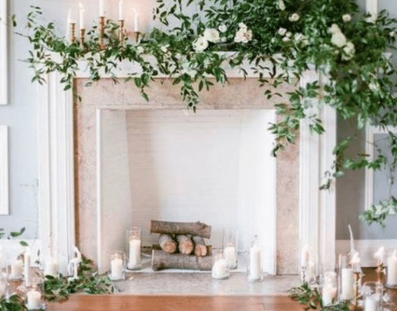 logs inside fire place| How to use your fireplace in spring
