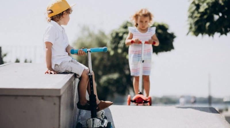 kids riding scooters| What makes a kidfriendly suburb
