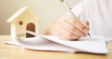 signing contract with silver pen| FIY Landlord Guide
