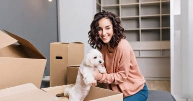 lady holding dog in box  How to simplify your house move