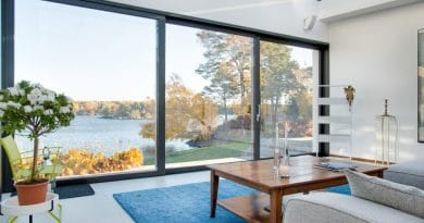 lounge room looking out to water| Turning your holiday spot to a fulltime residence