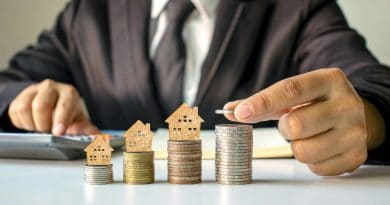 man stacking coins| Property investment jargons explained
